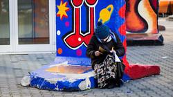 Lady Writing on Berlin Wall