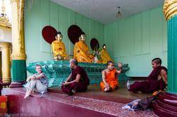 Buddhist monk and tourist chatting