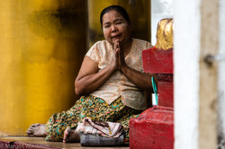 Burmese woman praying