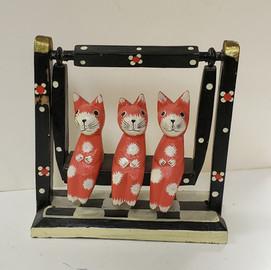 3 Swinging cats