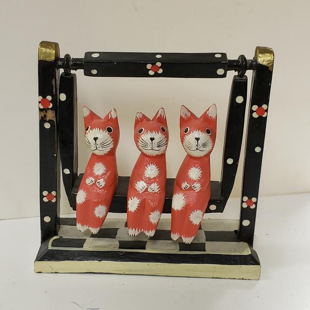 Swinging cats