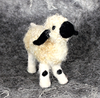 Needle felted black nosed sheep