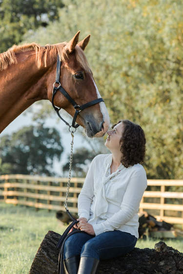 Chestnut eventer with owner