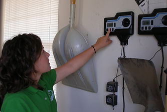 employee pointing to irrigation timer