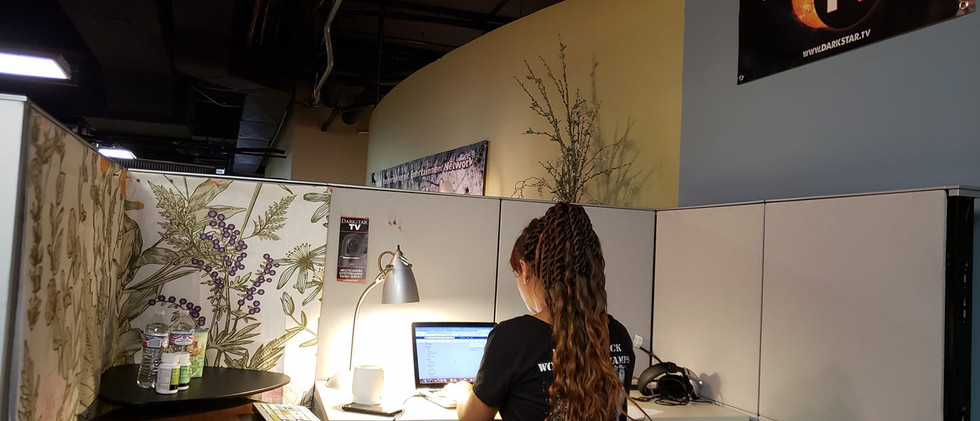 Jaslyn at her desk updating material for