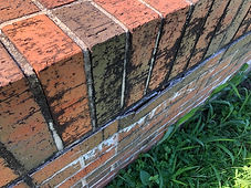 Bad bricks on sign base-2.jpg