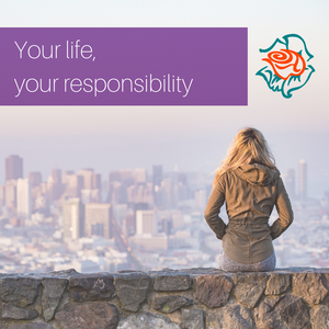 Woman on stone wall overlooking city | Metanao Counselling and Relationship Education