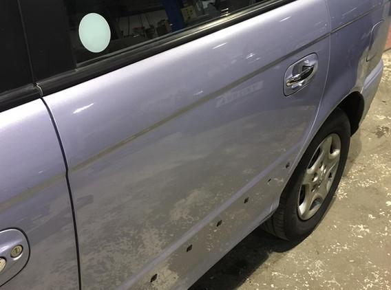 Badly Dented Rear Door