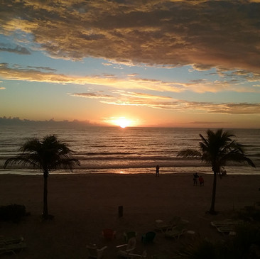 Sunset from beach partly cloudy.jpg