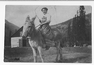 """Image: Pearl on Pat's donkey """"Maude,"""" before 1907. Moore family fonds, V439/PA - 215, Whyte Museum of the Canadian Rockies"""