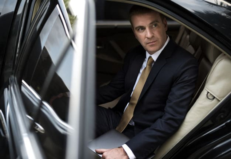 businessman-going-out-his-car_53876-9872