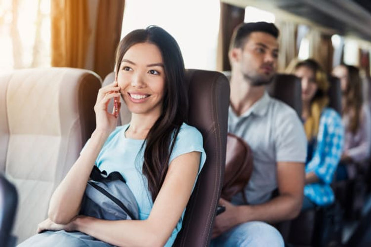 girl-talks-phone-passengers-travel-by-to