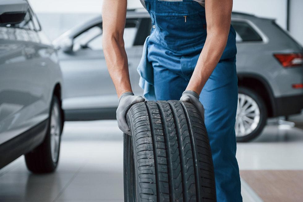 clean-room-mechanic-holding-tire-repair-