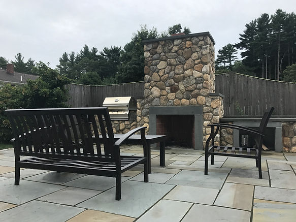bluestone patio with outdoor fireplace in marshfield ma