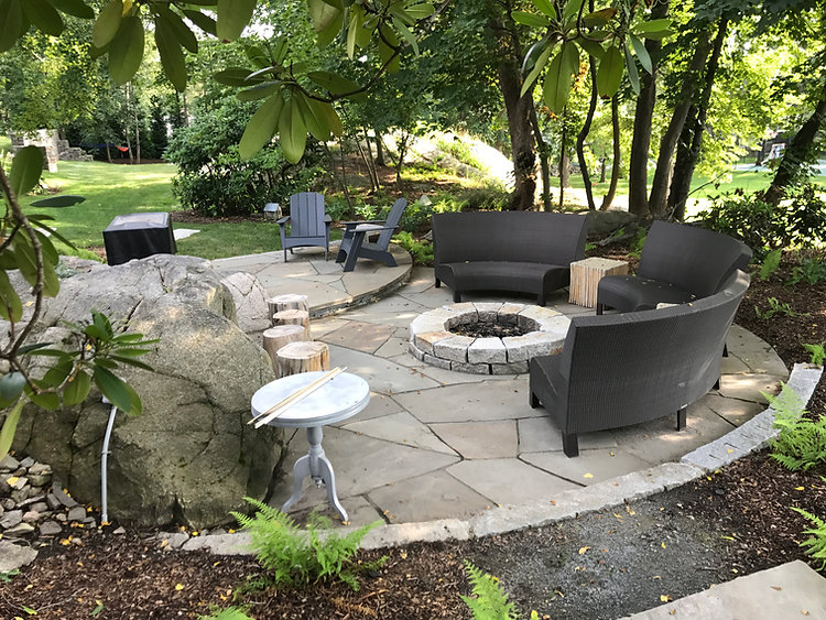 irregular bluestone patio with granite fire pit in hingham ma