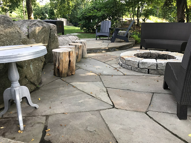 stone patio with granite fire pit in hingham ma