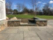 bluestone patio with stone sitting wall
