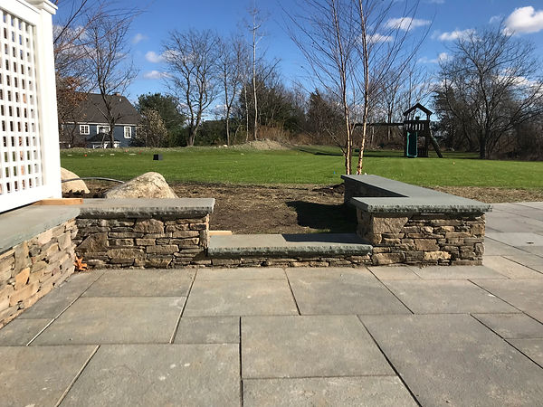 bluestone patio with stone sitting wall