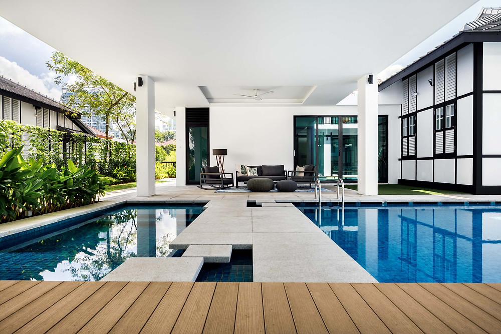 A black-and-white Good Class Bungalow at Cable Road by Designworx Interior Consultants has a conservation block—pool patio wraps around to give it a seamless flow outdoor  garden landscaping Good class bungalow  GCB Singapore  interior designers interior design timeless rooftop dining terrace  landed properties luxurious  landscaping ideas  landed properties outdoor lounge penthouses architect Singapore Pandemic