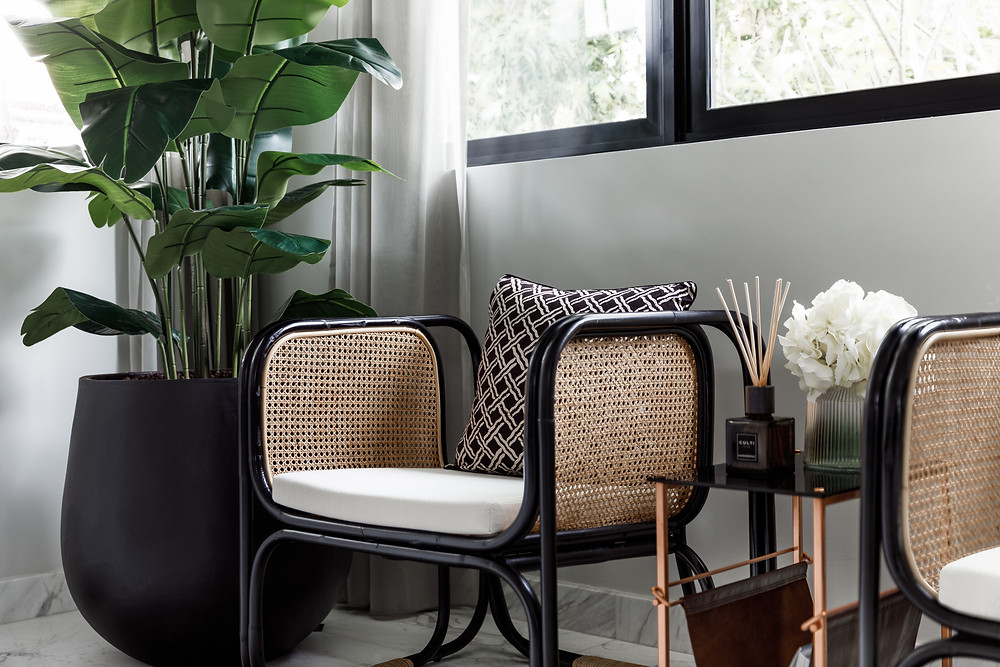 good class bungalow, cable road, rattan chair, geometric cushions