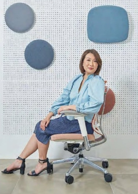 Terri Tan, design director of Designworx Interior Consultant; the Contessa II task chair from Okamura features the brand's iconic polished frame, and a backrest and seat in various colours such as the orange hue pictured here