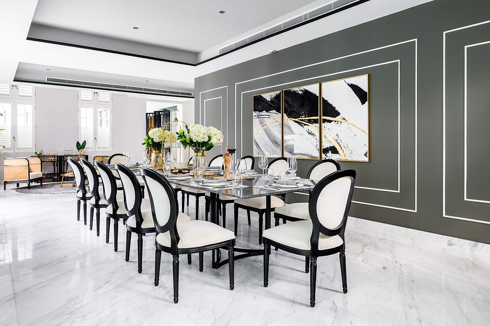 An abstract triptych is the focal point of the dining room
