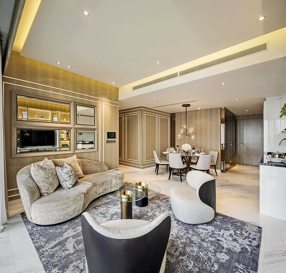 Wood-patterned wall panelling with white trimmings inject elegance into this unit at Wallich Residence ILuxurious interior design condominiums bungalows penthouse interior design tips Singapore tactile interiors award winning luxury textures
