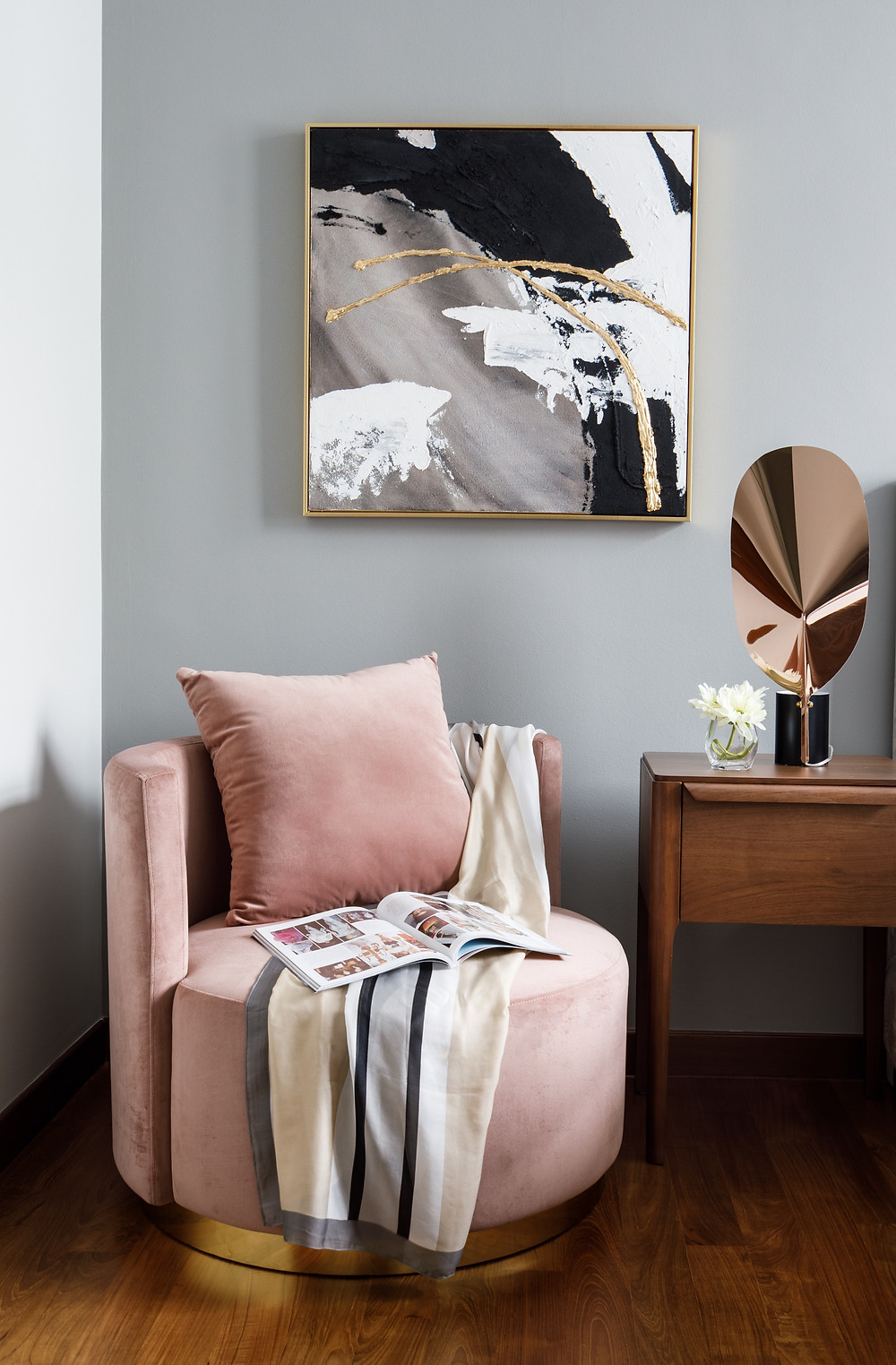velvet blush armchair, pink cushion, artwork, scarf