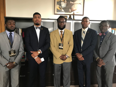 Delta Phi brothers with Bro. Adrian Scott, Director of Membership Services at the National Headquarters.