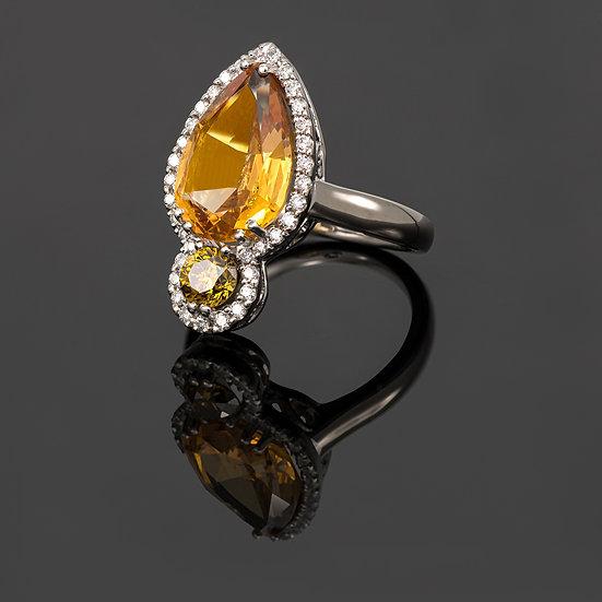 Inel din aur alb de 14 K cu topaz imperial si diamante de 0.64 CT.