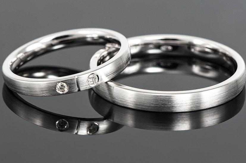 Pereche de verighete din aur alb de 14 K cu diamant de 0.05 CT.