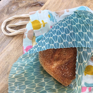 Beeswax Sandwich wrap and an organic cotton bread bag keeping bread fresher for longer