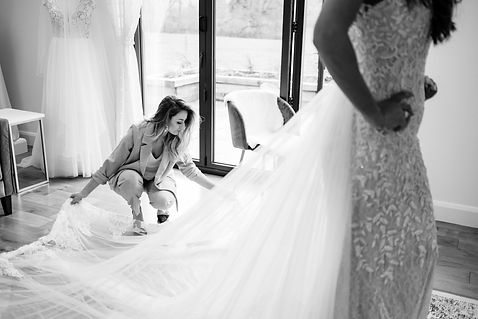 Claire, owner of Love in Lace wedding dress shop in Kent, assisting a bride-to-be at her wedding dress fitting.