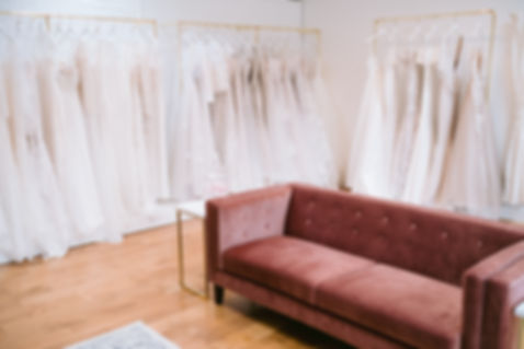 Wedding gowns lined up reading to be tried on by stylish brides-to-be at Love in Lace wedding dress boutique near Chiddingstone, Kent.