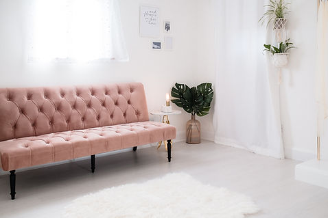 Simple, feminine, sophisticated modern interiors at Love in Lace bridal boutique in Kent, featuring dusky pink sofa and plants.