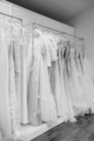 Range of stunning modern designer wedding gowns on show at Love in Lace bridal shop, Kent.