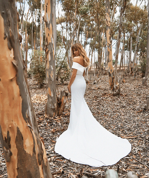 Plain wedding dress with stunning shape – Bardot neckline, off the shoulder, fit and flare bridal gown from Vagabond Bridal.