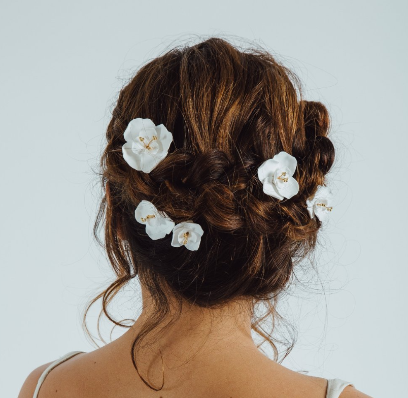 Handmade white porcelain flower bridal hair pins from Eden B Studio, perfect for that tousled bridal hair style.