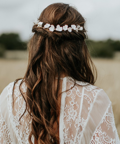 Back view of bridal hair showing hairvine by Eden B Studio, a wire vine bridal hair accessory with delicately handcrafted white porcelain flowers.