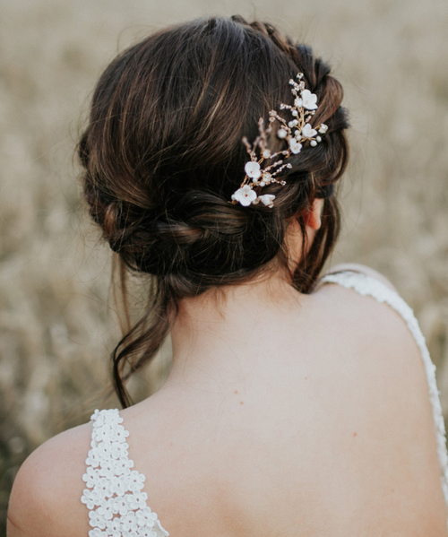 Pair of stunning hairpins from Eden B Studio for bridal hair, featuring handcrafted porcelain flowers, crystals and pearls.