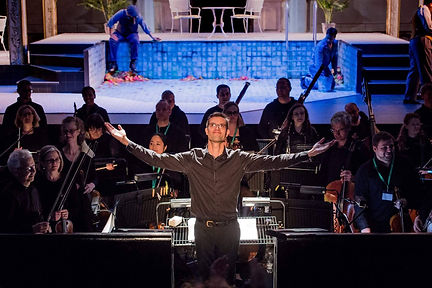 Matthew Kofi Waldren with the City of London Sinfonia at Opera Holland Park conducting La rondine in 2017. Photo credit: Robert Workman