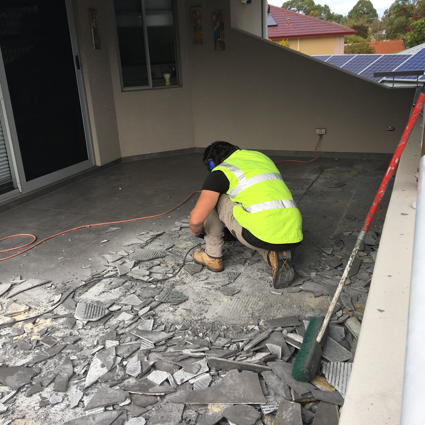 Conspar works begin at this Wembley Downs  property that has been experiencing water ingress problems. The first stage involves removing the original tiled floor of the balcony.