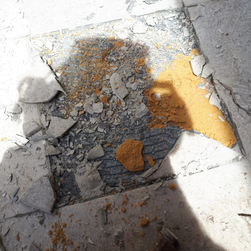 A destructive investigation of the tiled balcony floor of one of the apartments above the gymnasium, which was leaking, showed an inadequate waterproof membrane.