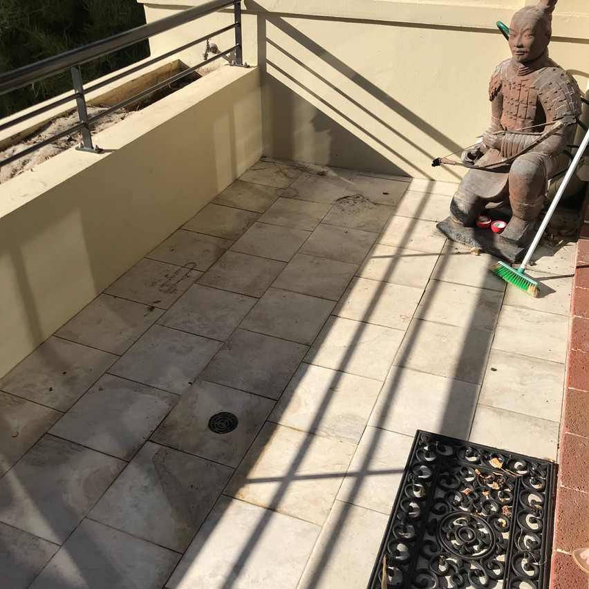 Conspar was asked to help rectify a water ingress problem at the gymnasium of this residential strata complex in Highgate. One of the focus areas for treatment is this tiled balcony and planter box area.