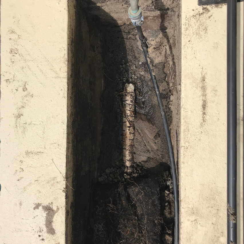 After removing the contents of the planter boxes at this apartment complex (Highgate, Perth) in order to install the waterproofing, the old drainage system was exposed.