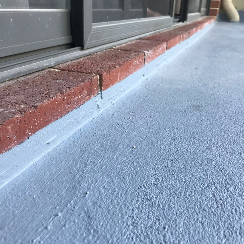As part of treating the water ingress, the balconies had to have their original tiles and screed removed, new screed installed and a waterproof membrane installed.