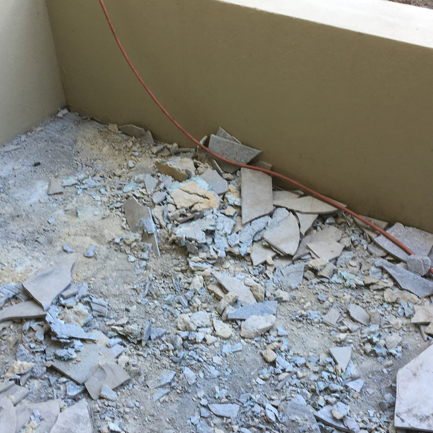 Conspar waterproofing works to help treat the water ingress problem involved removing all the tiles and screed from the balcony.