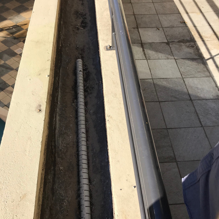 Planterbox waterproofing works underway at this building of apartments in Highgate (Perth). Addressing the drainage system is a component of the planterbox waterproofing works.