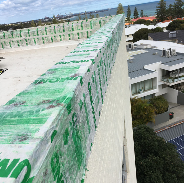Apartment Building Roof Restoration to Stop Water Leaks