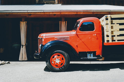 Canva - Orange Stake Truck Parked Beside